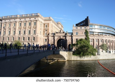 Stockholm, Sweden: aug 21, 2017 -Lion heads and Swedish Royal coat of arms on arched passageway in the Riksgatan district of Stockholm, Sweden