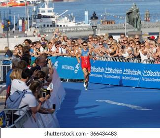 STOCKHOLM, SWEDEN - AUG 23, 2015: Triathlete Javier Gomez Noya a few meters before winning the triathlon event at the Men's ITU World Triathlon series event August 23, 2015 in Stockholm, Sweden