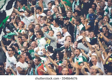 STOCKHOLM, SWEDEN - AUG 24, 2015: The fans of Hammarby after a goal in the soccer game the rivals Djurgarden and Hammarby at Tele2 arena.