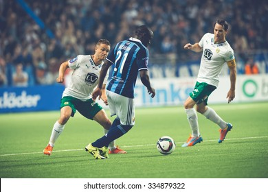 STOCKHOLM, SWEDEN - AUG 24, 2015: Mushekwi dribbling the ball at the soccer game between the rivals Djurgarden and Hammarby at Tele2 arena.
