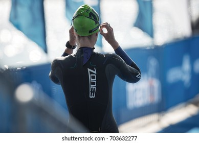 STOCKHOLM, SWEDEN - AUG 26, 2017: Triathlon female swimmers warming up and preparing out on the jetty. Female Olympic distance.