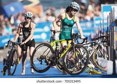 STOCKHOLM, SWEDEN - AUG 26, 2017: Ashleigh Gentle (AUS) and Andrea Hewitt (NZL) in the transition area between cycling and running at the womens ITU triathlon series. Female Olympic distance.