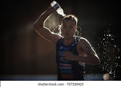STOCKHOLM, SWEDEN - AUG 26, 2017: Denis Vasiliev (RUS) running trough the waterstation at the ITU triathlon series for men. Olympic distance