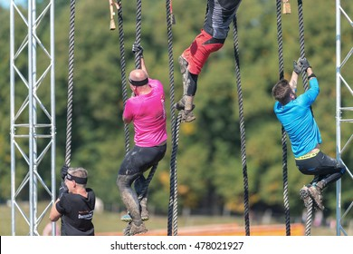 STOCKHOLM, SWEDEN - AUG 27, 2016: Rope climb at the Tough Viking event at Gardet in Stockholm.