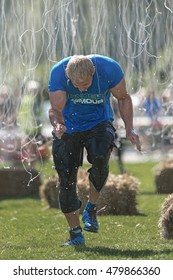 STOCKHOLM, SWEDEN - AUG 27, 2016: Finish 10.000 Volts by Reebok at the Tough Viking event at Gardet in Stockholm. Man running thru the elecrical with pain
