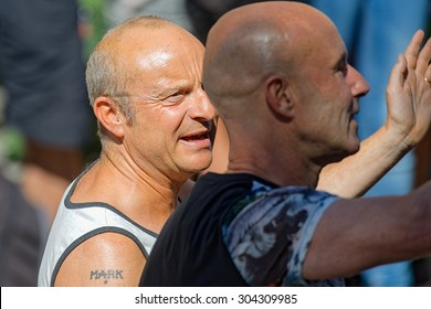 STOCKHOLM, SWEDEN - AUGUST 1, 2015: Jonas Gardell talking to his husband Mark Levengood at the Pride parade in Stockholm. Approx 400.000 spectators at the streets.