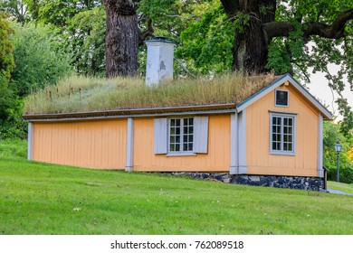 Stockholm, Sweden - August 10, 2017: Traditional Old Swedish house with a grass roof in a forest meadow
