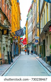 STOCKHOLM, SWEDEN, AUGUST 18, 2016: People are strolling on a street in the Gamla Stan district in central Stockholm, Sweden.