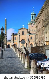 STOCKHOLM, SWEDEN - AUGUST 19, 2016: Church of St. Nicholas (Storkyrkan) and Obelisk located on the Slottsbacken street near the Royal Palace in Stockholm, Sweden on August 19, 2016.
