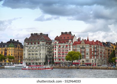 STOCKHOLM, SWEDEN - AUGUST 20, 2016: Many people walk and visit on Strandvagen street on Ostermalm distric with touristic sightseeing boats in Stockholm, Sweden on August 20, 2016.