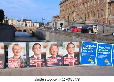 STOCKHOLM, SWEDEN - AUGUST 23, 2018: Liberals (Liberalerna) and Social Democrats (Socialdemokraterna) political posters before Swedish general election (scheduled for September 9, 2018).