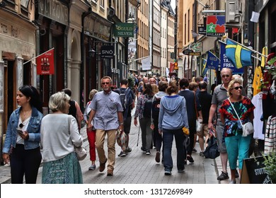 STOCKHOLM, SWEDEN - AUGUST 23, 2018: People shop in Gamla Stan (Old Town) in Stockholm, Sweden. Stockholm is the capital city and most populous area in Sweden.