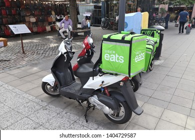 STOCKHOLM, SWEDEN - AUGUST 23, 2018: Uber Eats food delivery motorcycle in Stockholm, Sweden. This food delivery service is part of Uber ride sharing company.