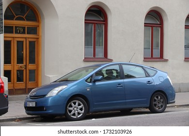 STOCKHOLM, SWEDEN - AUGUST 24, 2018: Blue Toyota Prius hybrid compact car parked in Stockholm, Sweden. There are 4.8 million passenger cars registered in Sweden.