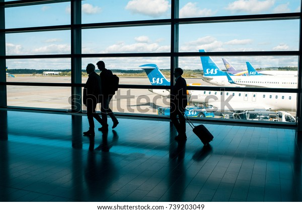 STOCKHOLM, SWEDEN- AUGUST 30 , 2017: Businessmen at the airport coming in for a landing. Aircraft airline SAS