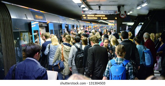 STOCKHOLM, SWEDEN - AUGUST 30 Subway train passengers crowding to get on and off subway station platform T-centralen, the hub of the Stockholm SL transportation system in Stockholm on August 30, 2012.