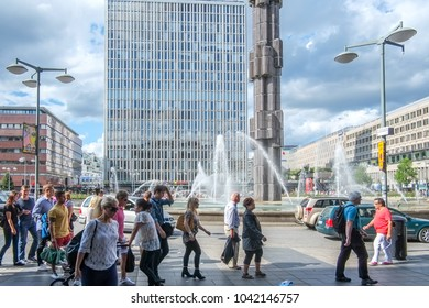 STOCKHOLM, SWEDEN - AUGUST 4, 2012: Sergel square and Sergel fountain during summer in Stockholm. The iconic glass obelisk in the fountain was installed in 1974.