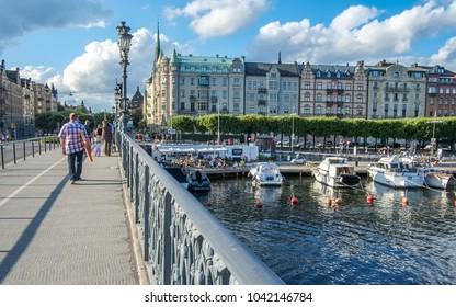 STOCKHOLM, SWEDEN - AUGUST 4, 2012: The bridge to Djurgården during summer in Stockholm. Djurgården is a famous recreational area in Stockholm.