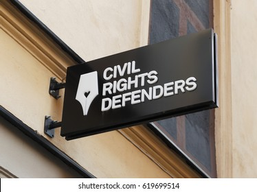 Stockholm, Sweden - August 4, 2014: The sign above the entrance to the organization Civil Rights Defenders at the street Stora Nygatan.