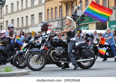 STOCKHOLM, SWEDEN - AUGUST 4: An unidentified woman on bike participates in the pride parade on August 4, 2012, Stockholm. Approximately 50,000 people march the parade and 500,000 bystanders watch the parade.
