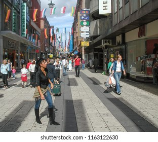 STOCKHOLM, SWEDEN - CIRCA AUGUST 2005: People in the city centre