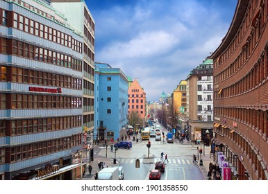 STOCKHOLM, SWEDEN - DEC 09. One of the main streets on December 09, 2019 in Stockholm, Sweden, Northern Europe. Old traditional and modern city houses, busy intersection, roads full of people and cars