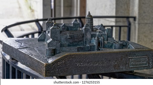 STOCKHOLM, SWEDEN - Dec 15, 2018: Bronze model of the castle Tre Kronor (Three Crowns) that burned down 1697, located in front of the Tre Kronor Museum entrance by the outside wall of the Royal Palace