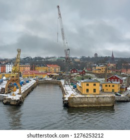 STOCKHOLM, SWEDEN - Dec 15, 2018: Crane like a giraffe were moved to the Old wharf at Beckholmen from Hammarby dockyard.