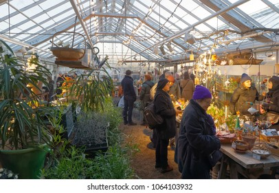STOCKHOLM, SWEDEN - DEC 17, 2017: People visiting a greenhous at the Christmas Fair show at Rosendal Garden in Stockholm, Sweden, December 17, 2017