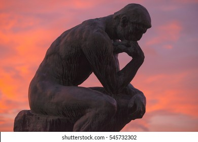STOCKHOLM, SWEDEN - DEC 30, 2016: Sculpture of the thinker of Rodin at Waldermarsudde in sunset light.