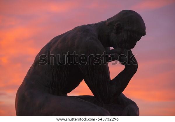 STOCKHOLM, SWEDEN - DEC 30, 2016: Sculpture of the thinker of Rodin at Waldermarsudde in sunset light.