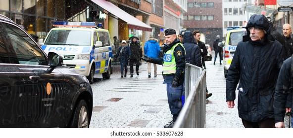 Stockholm, Sweden - December 10, 2016: Swedish police  let a car pass out from  Stockholm Concert Hall, Hotorget at the Nobel Prize Award Ceremony,