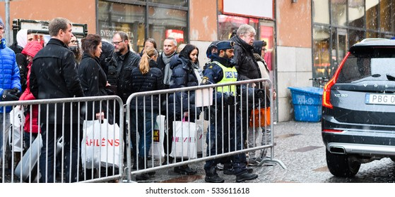 Stockholm, Sweden - December 10, 2016: Swedish police  closes gate to Stockholm Concert Hall, Hotorget at the Nobel Prize Award Ceremony, people passing are trying to get a glimpse of Nobel Laureates.