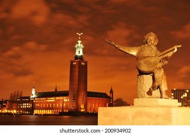 STOCKHOLM, SWEDEN - DECEMBER 12, 2011: Night view of Swedish Parliament (Sveriges riksdag), the national legislative assembly of Sweden.Night view of the City Hall (Stadshuset) in Stockholm, Sweden