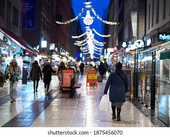 Stockholm, Sweden - December 13 2020 : Christmas shoppers and tourists on Drottninggatan (Queen street)