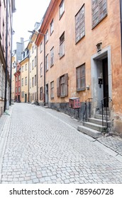 Stockholm, Sweden - December 19, 2017: View of narrow street and colorful buildings in Gamla Stan. The Old Town in Stockholm, Sweden.