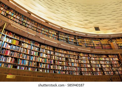 STOCKHOLM, SWEDEN, FEB 23, 2017: Interiour of the famous public library stadsbiblioteket in Stockholm, architect Gunnar Asplund. Many books on the shelfs.