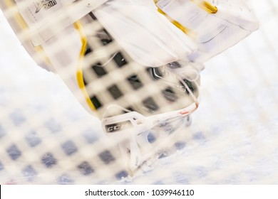 STOCKHOLM, SWEDEN, FEB 28, 2018: Skates of the goalkeeper Rautio (BIF) through the net in the SHL against DIF. Result 0-2 to BIF favor.