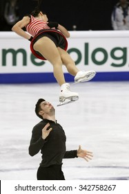 STOCKHOLM, SWEDEN -   FEBRUARY 1, 2015: Valentina MARCHEI / Ondrej HOTAREK of Italy perform during pair's free skating event at ISU European Figure Skating Championship in Globen Arena.