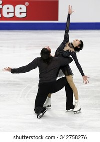 STOCKHOLM, SWEDEN -   FEBRUARY 1, 2015: Yuko KAVAGUTI / Alexander SMIRNOV of Russia perform during pair's free skating event at ISU European Figure Skating Championship in Globen Arena.