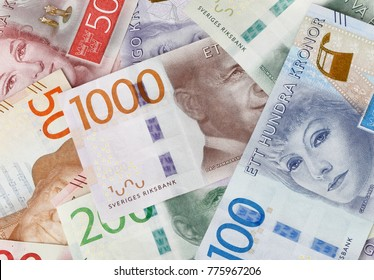 Stockholm, Sweden - February 10, 2017: Collection of Swedish banknotes introduced in 2015 and 2016 in varying denominations spread and covering the image area.