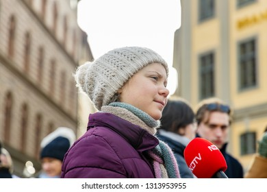 STOCKHOLM, SWEDEN - FEBRUARY 15, 2019: 16-year-old climate activist Greta Thunberg demonstrating outside the Swedish Parliament House (Riksdagshuset) interviewed by Indian NDTV