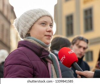 STOCKHOLM, SWEDEN - FEBRUARY 15, 2019: 16-year-old climate activist Greta Thunberg demonstrating outside the Swedish Parliament House (Riksdagshuset) on Fridays.