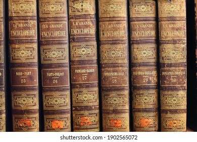 STOCKHOLM, SWEDEN - JAN 09, 2020. A row of vintage books, several volumes of large encyclopedia (la grande encyclopadie), french language, brown binding with gold lettering in Stockholm Public Library