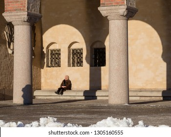 Stockholm, Sweden - Jan 20.2019: Sunbathing on the terrace under City Hall (Stadshus, Stadshuset). Sunny winter day with a freezing temperature.