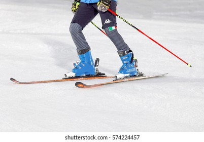 STOCKHOLM, SWEDEN - JAN 31, 2017: Closeup of the skiis and legs of officials inspecting the ski slope used for parallel slalom, at the Alpine Audi FIS Ski World Cup. January 31, 2017, Stockholm,Sweden