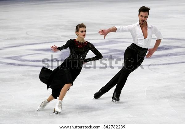 STOCKHOLM, SWEDEN - JANUARY 28, 2015: Gabriella PAPADAKIS / Guillaume CIZERON of France perform short dance at ISU European Figure Skating Championship in Globen Arena.