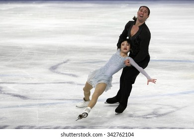 STOCKHOLM, SWEDEN - JANUARY 30, 2015: Yuko KAVAGUTI / Alexander SMIRNOV of Russia perform during pairs short program at ISU European Figure Skating Championship in Globen Arena.