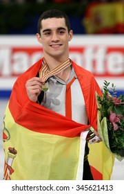 STOCKHOLM, SWEDEN - JANUARY 30, 2015: Javier FERNANDEZ of Spain poses with gold medal during men's victory ceremony at ISU European Figure Skating Championship in Globen Arena.