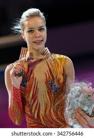 STOCKHOLM, SWEDEN - JANUARY 31, 2015: Anna POGORILAYA poses with bronze medal during ladies victory ceremony at ISU European Figure Skating Championship in Globen Arena.